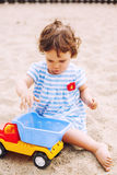 Baby playing on beach Stock Image