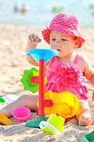 Baby playing on the beach Stock Photography