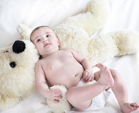 The baby is playing with  bear Stock Photo