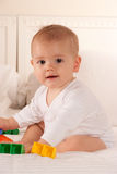 Baby playing on a bed Stock Photography