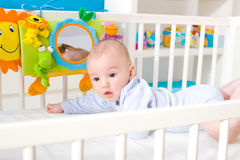 Baby playing in bed royalty free stock image