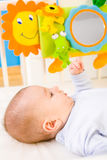 Baby playing in bed stock photo
