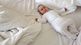 Baby Playing On A Bed stock footage