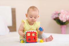 Baby is playing in bed. royalty free stock photography
