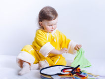 Baby playing with bibs in studio Royalty Free Stock Photography