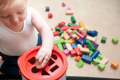 Baby playing with blocks and sorting shapes Stock Image