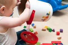 Baby playing with blocks and sorting shapes Stock Photos