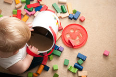 Baby playing with blocks and sorting shapes Royalty Free Stock Photo