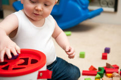 Baby playing with blocks and sorting shapes Royalty Free Stock Image