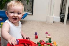 Baby playing with blocks and sorting shapes Royalty Free Stock Images