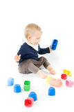 Baby playing with blocks on white background Stock Photos