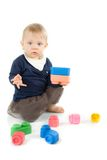 Baby playing with blocks on white background Royalty Free Stock Photography
