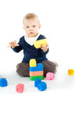Baby playing with blocks on white background Stock Image