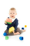Baby playing with blocks on white background Royalty Free Stock Photo