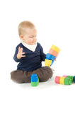Baby playing with blocks on white background Royalty Free Stock Images