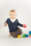 Baby playing with blocks on white background Stock Images