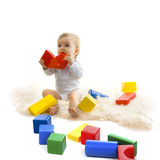 Baby playing with bright blocks Stock Photography