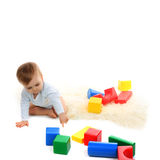 Baby playing with bright blocks Royalty Free Stock Images