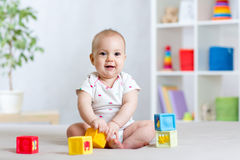 Baby playing with building block toys Stock Images