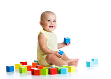 Baby playing with building block toys Stock Image