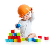 Baby playing with building blocks toy. Kid playing with building blocks toy stock photo