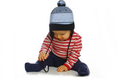 Baby playing a cap. A baby playing a blue cap in the pantyhose Royalty Free Stock Photo