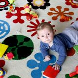 Baby playing on carpet. Baby boy crawling and playing on carpeted floor Royalty Free Stock Photo