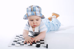 Baby playing checkers on white Royalty Free Stock Photos