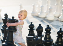 Baby playing in chess Royalty Free Stock Image