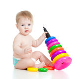 Baby playing with color challenging toy Stock Images