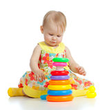 Baby playing with color developmental toy Royalty Free Stock Image