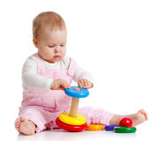 Baby playing with color toy. Child playing with color pyramidion Stock Image