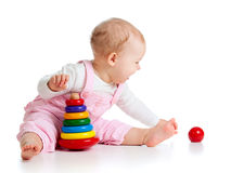 Baby playing with color toy. Child playing with color pyramidion Royalty Free Stock Photography