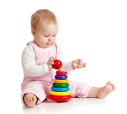 Baby playing with color toy Royalty Free Stock Photos