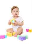 Baby playing with colored blocks Royalty Free Stock Photography