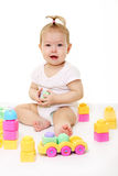 Baby playing with colored blocks Stock Photo