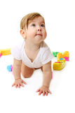 Baby playing with colored blocks Stock Images