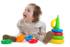 Baby is playing with colored toy pyramid Royalty Free Stock Image