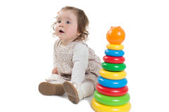 Baby is playing with colored toy pyramid Stock Images