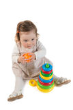 Baby is playing with colored toy pyramid Royalty Free Stock Photo