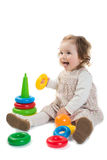 Baby is playing with colored toy pyramid Stock Photo