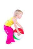 Baby playing with colorful ball. Over white stock images