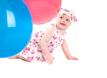 Baby playing with colorful balloons Royalty Free Stock Photo