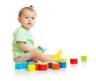Baby playing with colorful blocks isolated stock photo