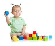 Baby playing with colorful building blocks Royalty Free Stock Images