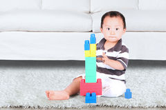 Baby playing with colorful lego Stock Images