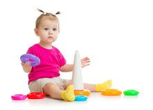 Baby playing with colorful pyramid isolated Stock Images
