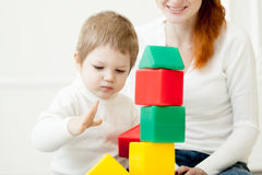 Baby playing with colorful toy blocks Royalty Free Stock Photography