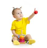 Baby playing with colorful toy and pointing by Stock Photo