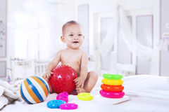 Baby playing with colorful toys Royalty Free Stock Photo
